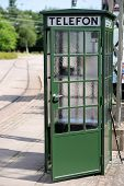 foto of phone-booth  - Classical old green phone booth with open door.