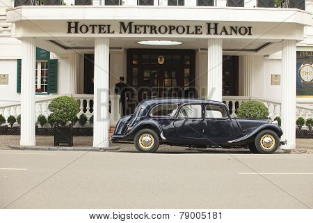 Old Citroen car parking in front of Hotel Sofitel Legend Metropole Hanoi