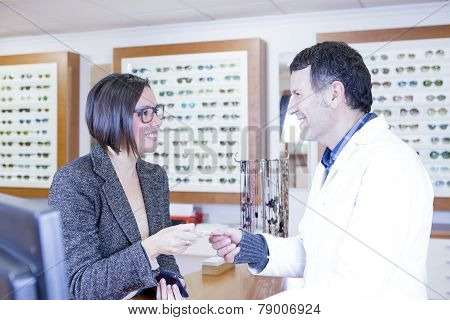 Woman Paying At Optical Shop