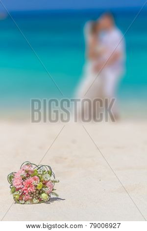 beautiful wedding bouquet on bride and groom background, outdoor beach wedding