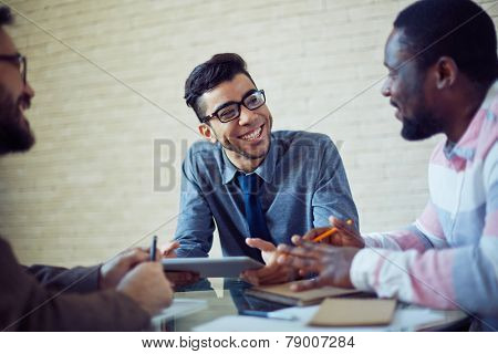 Group of modern managers speculating about working plans