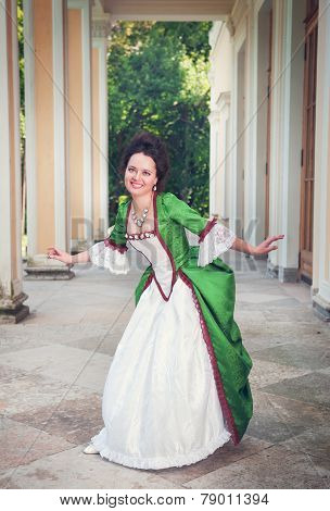 Beautiful Woman In Green Medieval Dress Doing Curtsey