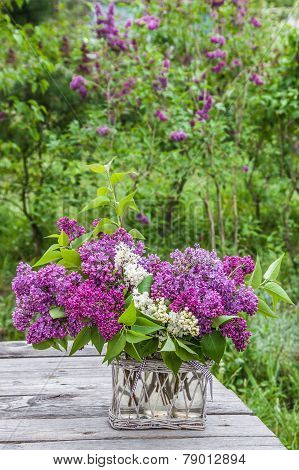 Bouquet Of Lilac On The Table In The Garden