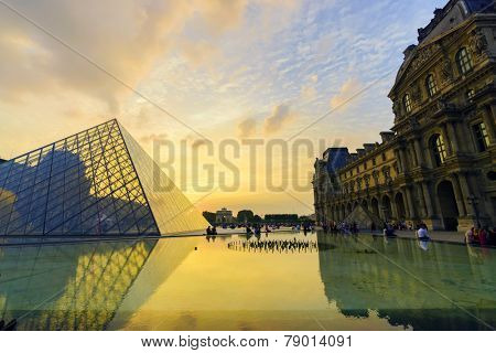 PARIS - SEPTEMBER 06: The Louvre Palace and the Pyramid on September 06, 2014 in Paris, France. The Louvre or the Louvre Museum is one of the world's largest museums and a historic monument.
