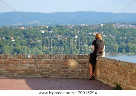 woman red hair looking at the landscape from Petrovaradin Fortress, Serbia