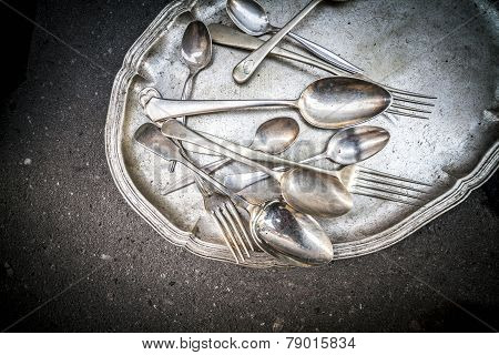Vintage Spoons, Teaspoons And Forks On A Silver Tray.
