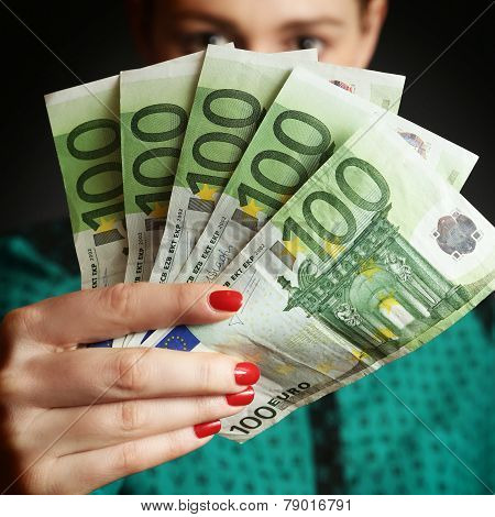 Woman holding euro bills