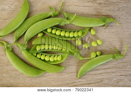 Fresh Sugar Snap Peas On Wooden Background