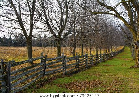 Old wooden fence in the country in winter