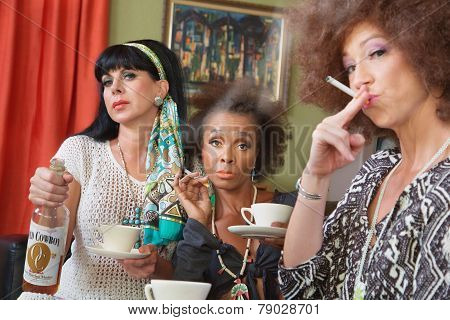Three Women Drinking And Smoking