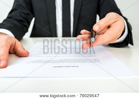 Businessman Offering You To Sign A Document With Focus To The Text Terms And Conditions