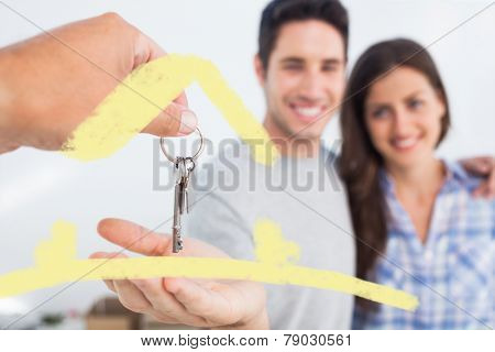 Man being given a house key against house outline