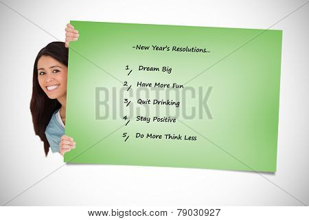 Beautiful woman hidding behind a listagainst green card