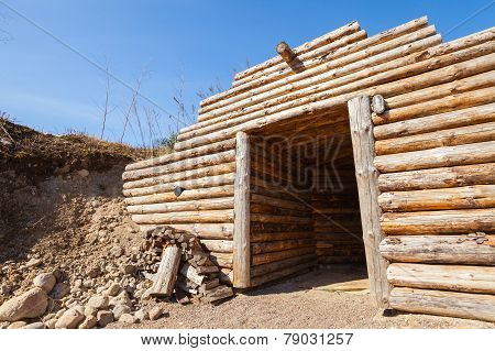 Wooden Wall And Open Door Of Old Underground Sauna