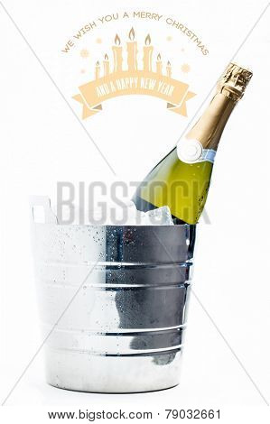 Merry Christmas message against bottle of champagne chilling in ice bucket