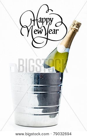 Happy new year against bottle of champagne chilling in ice bucket