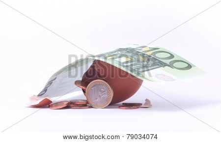 1 Euro Coin Getting Out Of Cracked Hatched Egg Under 100 Euro Banknote. Symbol For Investment, Econo
