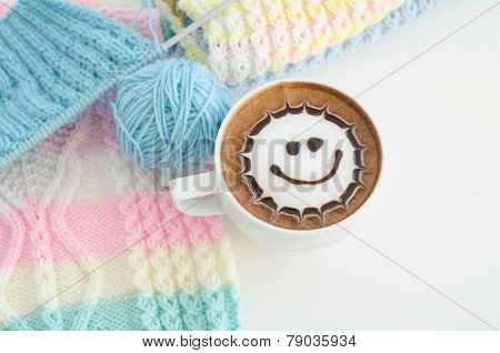 A Cup Of Latte Art And Knitted Vest