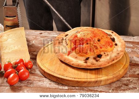 Preparing calzone pizza bread.