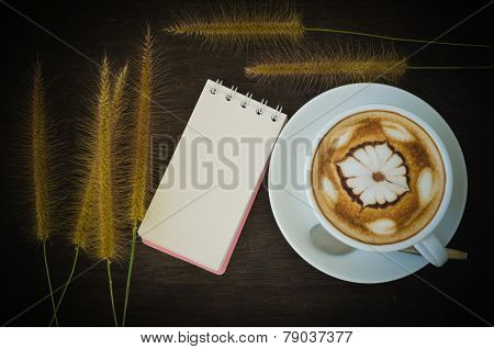 Latte Art Coffee And Notebook On Wooden Background