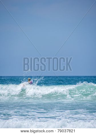 Surfer Surfing in Kuta Bali Indonesia