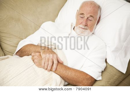 Senior Man Sleeps On Couch