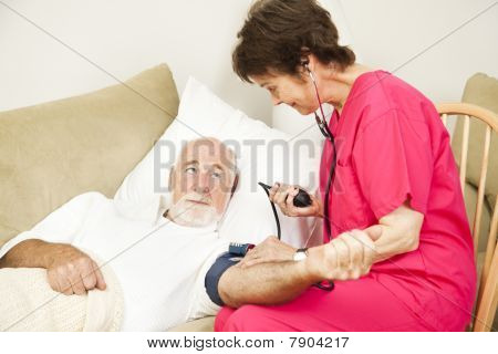 Home Health Nurse Takes Blood Pressure
