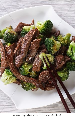 Asian Beef With Broccoli And Chopsticks. Vertical Top View