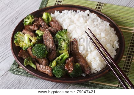 Asian Beef With Broccoli And Rice Close-up. Horizontal