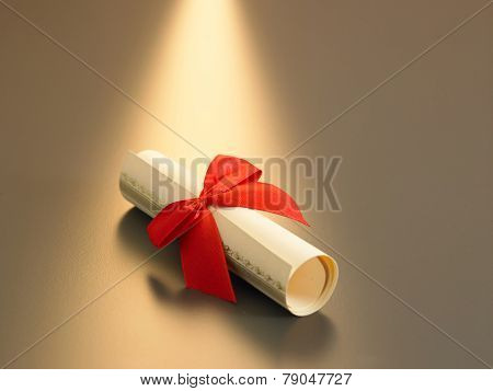 roll up certificate with red ribbon