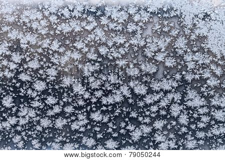 Snowflake And Frost On Frozen Windowpane In Winter
