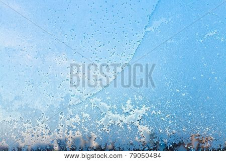 Window Pane With Frost Pattern In Cold Winter