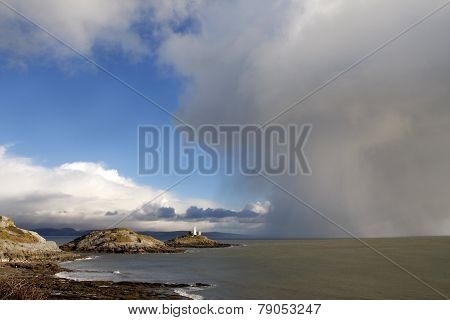 Lighthouse And Approaching Storm