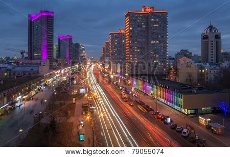 MOSCOW, RUSSIA - NOV 16, 2014: Traffic on New Arbat Avenue near the highrise buildings at evening