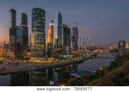 MOSCOW, RUSSIA - SEP 20, 2014: Building of Moscow International Business Center (Moscow-City) on the bank of the river in the evening