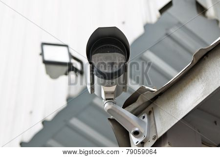 Cctv Security Camera At The Wall
