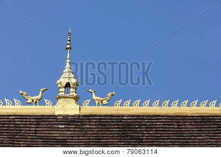 Roof top on blue sky of Laos temple