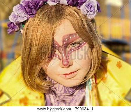 Young Girl teenager with body art face painted Outdoor Lifestyle and Fashion concept