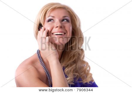 Smiling Girl Speaks On The Mobile Phone