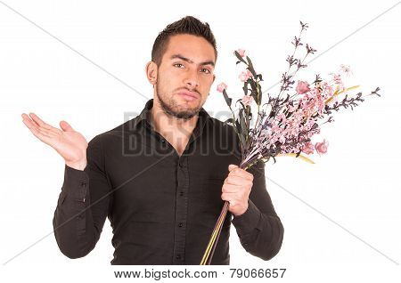 handsome young man holding a flower bouquet