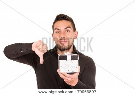 handsome young man holding a gift box