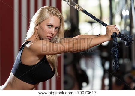 Woman Doing Heavy Weight Exercise For Triceps