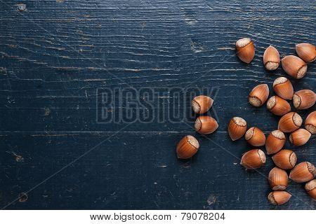 hazelnuts on the blue wooden table