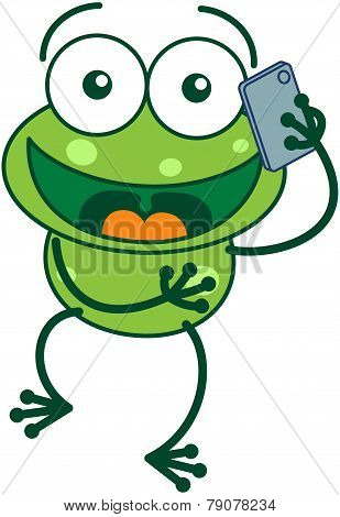 Green frog talking on a smartphone