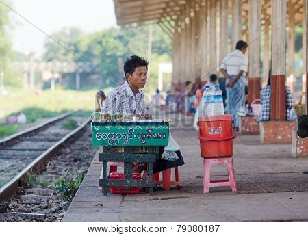 Vendor At A Railway Station In Yangon, Myanmar.