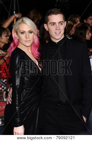 LOS ANGELES - NOV 11:  Casey LaBow & Date arrives to the