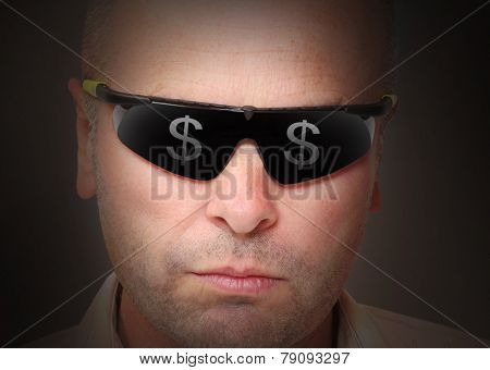 Portrait of man in sunglasses with dollar symbols reflecting.