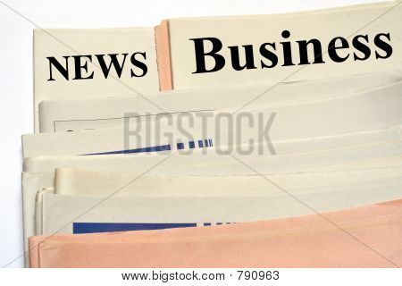 Stacked Business Newspapers