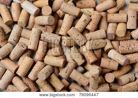 Closeup of a pile of used wine corks. Horizontal format with the corks filling the frame.
