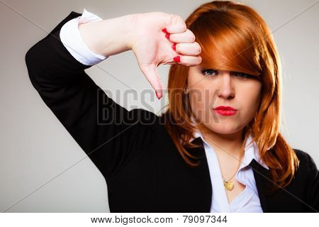 Unhappy Woman Giving Thumb Down Gesture